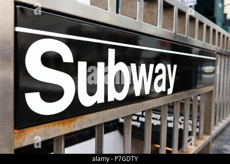Subway sign in New York City for underground entrance - Stock Photo
