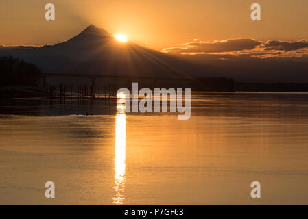 Golden tranquil sunrise over Mt Hood and the Columbia River, Pacific Northwest United States - Stock Photo