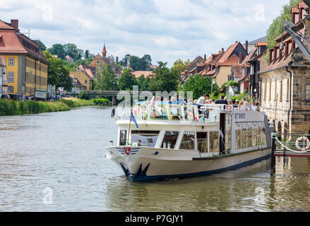 BAMBERG, GERMANY - JUNE 19: Tourists on a passenger ship at river Regnitz in Bamberg, Germany on June 19, 2018. - Stock Photo