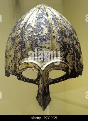 Period of Golden Horde (Ulus Jochi). 13th-14th c. Helmet with a half-mask, eye slits and nose guard. Iron, gilding. The State Hermitage Museum. Saint Petersburg. Russia. - Stock Photo