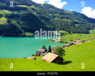 Beautiful view of Thunersee (Lake Thun), Thun, Switzerland, Europe in a sunny summer day with miniature style. - Stock Photo