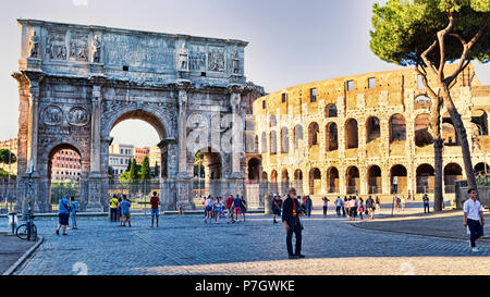 Rome, Italy - June 30, 2018: View of the Arch of Constantine and the Colosseum from Via dei Fori Imperiali, around some tourists and photographers  en - Stock Photo