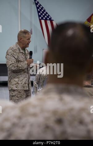 UNDISCLOSED LOCATION, MIDDLE EAST – U.S. Marine Corps Gen. Robert B. Neller, the Commandant of the Marine Corps, addresses Marines and Sailors from Special Purpose Marine Air-Ground Task Force, Crisis Response-Central Command June 26, 2018. Neller praised Marines for their unit's performance thus far and encouraged them to stay on the right path. (U.S. Marine Corps photo by Sgt. Royce Dorman) - Stock Photo