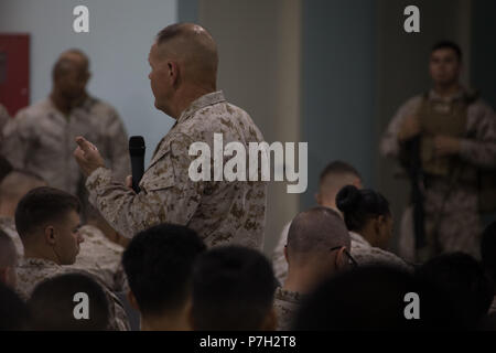 UNDISCLOSED LOCATION, MIDDLE EAST – U.S. Marine Corps Gen. Robert B. Neller, the commandant of the Marine Corps, addresses Marine and Sailors from Special Purpose Marine Air-Ground Task Force, Crisis Response-Central Command June 26, 2018. Neller praised Marines for their unit's performance thus far and encouraged them to stay on the right path. (U.S. Marine Corps photo by Sgt. Royce Dorman) - Stock Photo