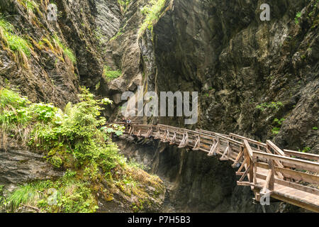 Wooden bridge on a rock face in the gorge, Sigmund-Thun-Klamm, Kaprun, Salzburg, Austria - Stock Photo