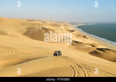 4x4 drives over the sand dunes, Namib Desert, Namibia - Stock Photo