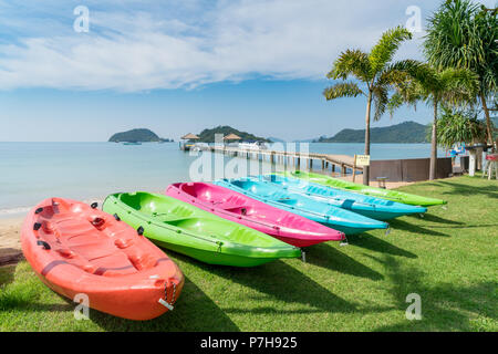 Colorful kayaks on the tropical beach in Phuket, Thailand. Summer, Vacation and Travel concept. - Stock Photo