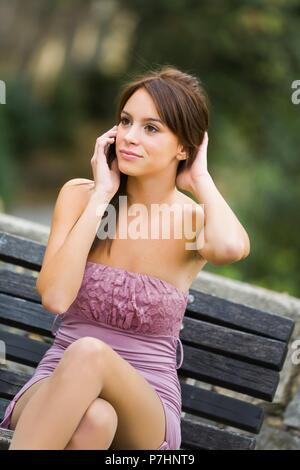 Brunette woman dressed tight Violet dress teen teenage teenager teen girl teengirl - Stock Photo