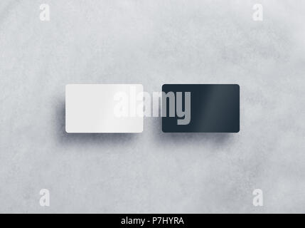 Two blank plastic business cards mockups set isolated on grey textured background. Black and white namecard design mock up presentation. Empty horizontal visiting sheets template with shadows. - Stock Photo