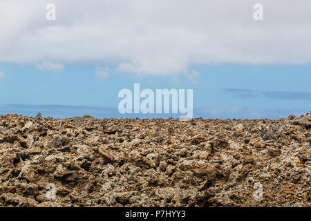 Volcanic rock from lava flow. Lava field in Timanfaya National Park in Lanzarote, Canary Islands, Spain. - Stock Photo