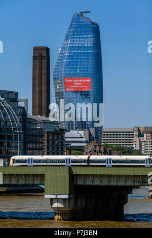 A Train Crosses Over Cannon Street Railway Bridge With The No 1 Blackfriars Building In The Backround, London, England - Stock Photo