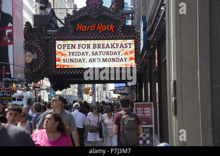 June 21st, the first day of summer, and Times Square on and around 7th Avenue is packed with tourists day and night. - Stock Photo