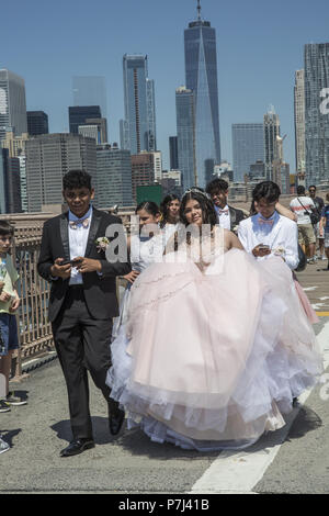 Quinceañera, quince años and quince) is a celebration of a girl's 15th birthday. It has its cultural roots in Latin America but is widely celebrated today throughout the Americas. The girl celebrating her 15th birthday is a quinceañera. Birthday girl with family & friends walks across the Brooklyn Bridge in NYC. - Stock Photo