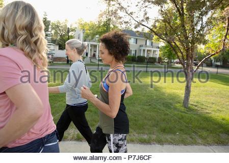 Senior women walking, exercising in park - Stock Photo