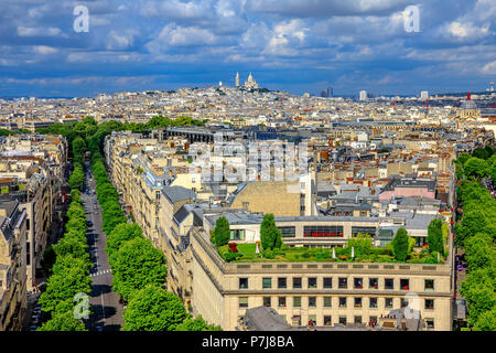 Paris skyline aerial view panorama from top of Arc de Triomphe. Distant Sacre-Coeur church of Paris or Sacred Heart Basilica Landmark in Paris, France, Europe. - Stock Photo