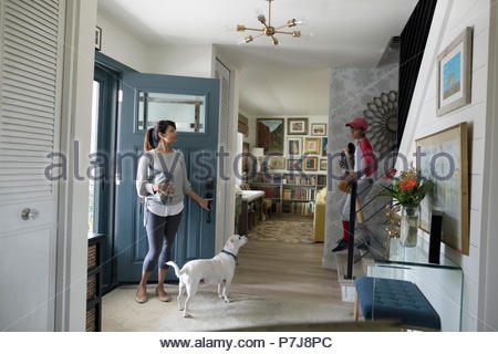 Woman and dog waiting in foyer - Stock Photo
