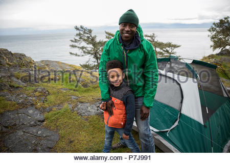 Portrait smiling father and son camping - Stock Photo