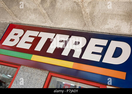 Sign for the gambling brand Betfred in Birmingham, United Kingdom. - Stock Photo