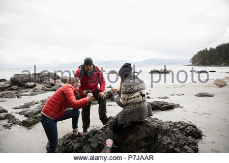 Family on rugged beach - Stock Photo