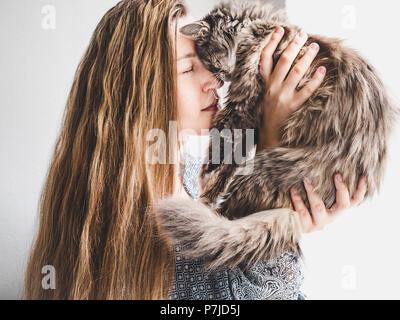 Stylish woman and fluffy kitten - Stock Photo