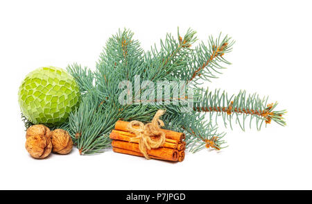 Christmas decoration with fir branches, cinnamon sticks and nuts - Stock Photo