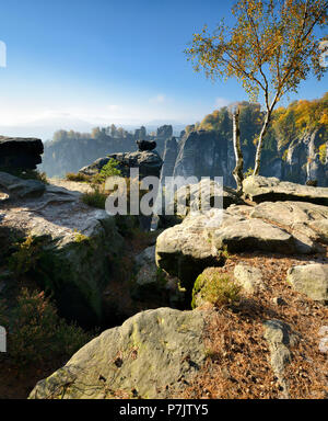 Germany, Saxony, Rathen, Elbe Sandstone Mountains, Saxon Switzerland National Park, view of Bastei Bridge in autumn - Stock Photo