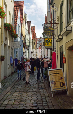 Germany, Hanseatic City of  Bremen, 'Schnoorviertel' (the oldest residential district and artist's quarter in Bremen), 15th to 18th century town houses, old lane with shops and bars, - Stock Photo