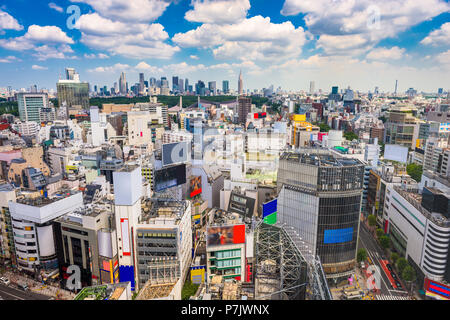 Shibuya, Tokyo, Japan city skyline towards Shinjuku Ward in the distance. - Stock Photo