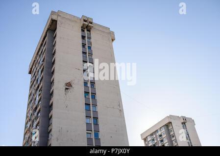 Residential building damaged by artillery shelling of the Bosnian Civil War, Sarajevo, Bosnia and Herzegovina - Stock Photo