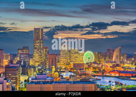 Yokohama, Japan harbor and downtown skyline at dusk. - Stock Photo