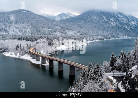 The bridge and federal highway over the Sylvenstein reservoir in wintertime, - Stock Photo