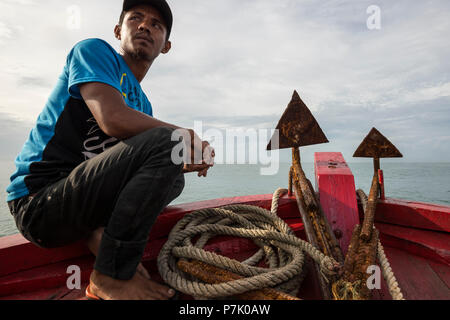 Boatswain at the bow of the ferry to the Banyak Islands - Stock Photo
