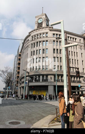 Cityscape of streets of Ginza District in Tokyo, Japan – jan 24, 2011. Ginza Wako building with large Seiko clock - Stock Photo