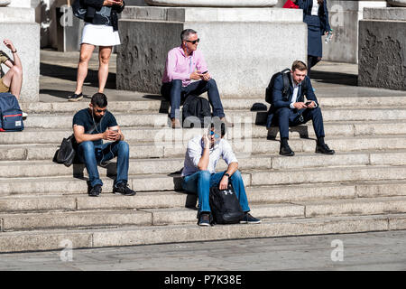 London, UK - June 22, 2018: Closeup of people resting sitting at Royal Exchange steps, stairs, entrance in center of downtown financial district city, - Stock Photo