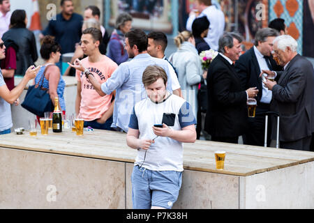 London, UK - June 22, 2018: Crowd of many people standing by London Bridge street road in center of downtown city, England, by the Shipwrights Arms pu - Stock Photo
