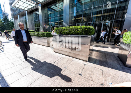 London, UK - June 26, 2018: Entrance exterior to JP Morgan office financial bank building in Canary Wharf Docklands, architecture during morning rush  - Stock Photo