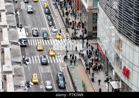 New York City, USA - April 7, 2018: Aerial view of urban building in NYC Herald Square Midtown with security cameras on road 6th avenue street, HM - Stock Photo