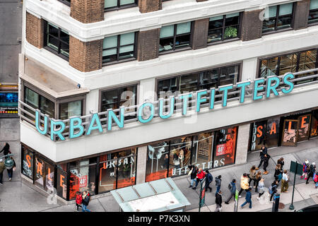 New York City, USA - April 7, 2018: Aerial view of urban outfitters retail clothing store sign building in NYC Herald Square Midtown closeup - Stock Photo
