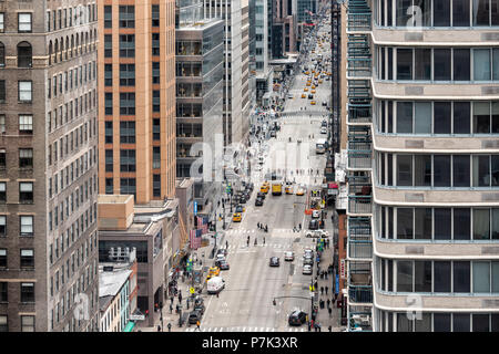 New York City, USA - April 7, 2018: Aerial view looking down of urban street from rooftop building in NYC Herald Square Midtown with 6th avenue road,  - Stock Photo