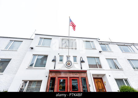 Reykjavik, Iceland - June 19, 2018: United States of America USA embassy with sign, flag in downtown capital city building architecture white exterior - Stock Photo