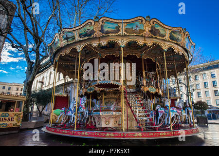 French old-fashioned style carousel with stairs at Place de l'Horloge in Avignon France - Stock Photo