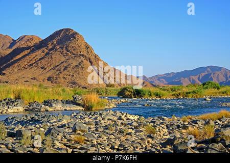 stony river bed of the Orange River / Oranjerivier (border river) in Richtersveld, opposite side of Namibia, Namaqua, South Africa - Stock Photo