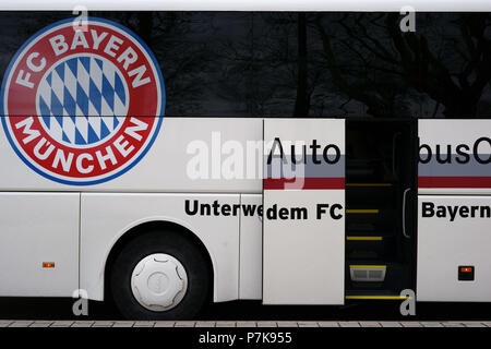 The emblem of the football club FC Bayern Munich on the team bus at a game in Stuttgart, - Stock Photo