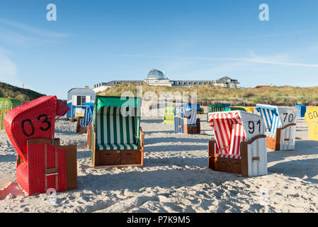 Germany, Lower Saxony, East Frisia, Juist, beach chairs on the beach at the former spa hotel, now hotel. - Stock Photo