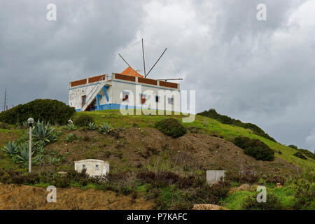 Windmill in the fishing village Carrapateira, Parque Natural do Sudoeste Alentejano and Costa Vicentina, Algarve - Stock Photo