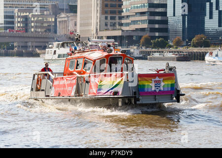 London, UK. 6th July 2018. A London Fire Brigade boat with London Pride rainbow flags seen on the River Thames, joined by the other emergency services who work on the river. Credit: Vickie Flores/Alamy Live News - Stock Photo