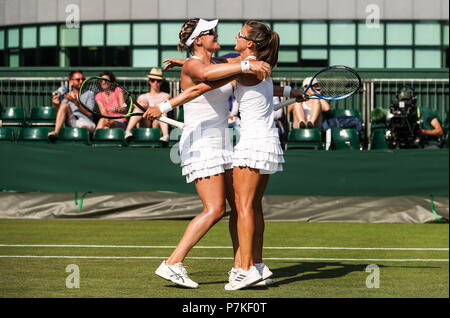 London, UK. 6th July, 2018. Abigail Spears (L) of the United States and Alicja Rosolska of Poland cekebrate during the women's doubles second round match against Peng Shuai of China and Latisha Chan of Chinese Taipei at the Wimbledon Championships 2018 in London, Britain on July 6, 2018. Abigail Spears and Alicja Rosolska won 2-0. Credit: Tang Shi/Xinhua/Alamy Live News - Stock Photo