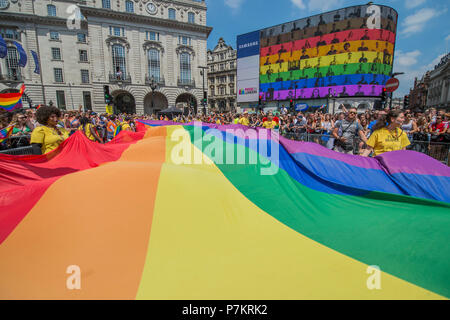 London, UK. 7th July 2018. A pride design on the Piccadilly Circus screen as the giant Pride flagpasses by - The London Pride parade and event in Trafalgar Square. Credit: Guy Bell/Alamy Live News - Stock Photo