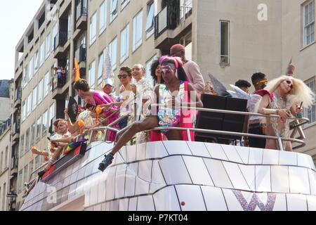 London, UK. 7th July 2018. Pride celebrations in London London, UK. 7th July 2018. The Pride in London 2018 Parade float for W Hotel featuring people partying on the top of the bus, joining more than 1 million attending the march today to celebrate LGBT+ Credit: Dimple Patel/Alamy Live News - Stock Photo