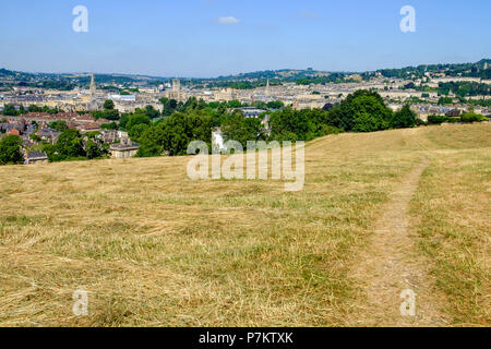 Bath, UK, 7th July, 2018.  With the city of Bath in the background and after several weeks without significant rainfall, Bathwick meadow is pictured as the grass starts to turn a golden yellow colour. Credit: lynchpics/Alamy Live News Credit: lynchpics/Alamy Live News - Stock Photo